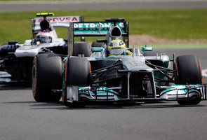 Rosberg triumphs in incident-packed British GP