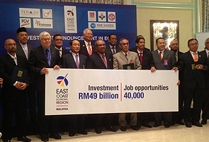 Najib witnesses RM750 million worth of MoUs signed for ECER