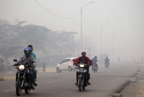 Haze returns to Indonesia as fires rage