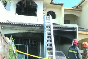 Mother, son die in Ipoh terrace house fire