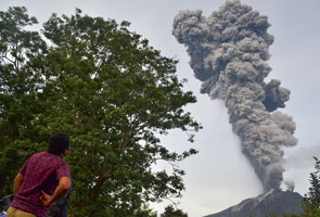 Two Indonesian volcanoes erupt, flights disrupted