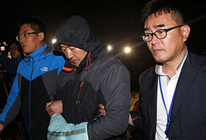 South Korea ferry captain arrested, divers spot bodies
