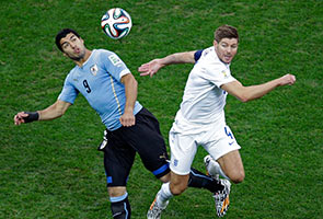 LUIS SUAREZ SCORES TWICE AS URUGUAY DOWNS ENGLAND 2-1