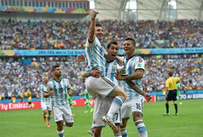 MESSI MAGIC AS ARGENTINA MARCH ON