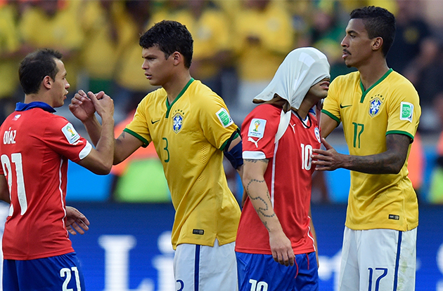 Chile's Marcelo Diaz, left, and Jorge Valdivia are greeted by Brazil's Thiago Silva  and Luiz Gustavo, right, after a penalty  shoot out at the end of the World Cup round of 16 soccer match between Brazil and Chile at the Mineirao Stadium in Belo Horizonte, Brazil, Saturday, June 28, 2014. Brazil won the match 3-2 on penalties after the match ended 1-1. (AP Photo/Martin Meissner)
