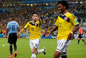 JAMES RODRIGUEZ LEADS COLOMBIA PAST URUGUAY, 2-0