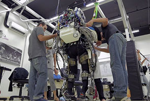 PARAPLEGIC IN 'IRON MAN' BODYSUIT TO OPEN WORLD CUP
