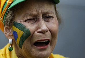 WORLD CUP: BRAZILIANS CRY AND CURSE AT HUMILIATION