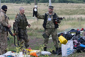MH17: Anger boils over reports of looting at crash site
