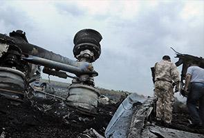 MH17: Crew's families react to crash reports