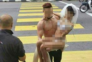 Bandar Ipoh dikejutkan dengan aksi pengantin separuh bogel