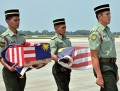 Aircraft bearing remains of MH17 victims on the way home