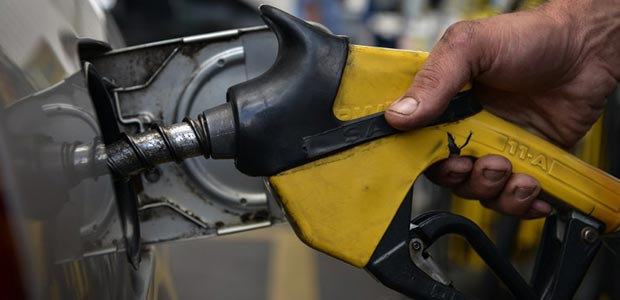 The Government has decided to reduce the fuel subsidy by 20 sen/litre. - AFP Photo/Yasuyoshi Chiba