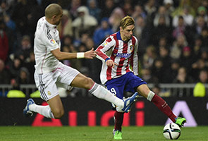 Torres scored twice to dump Real Madrid out of Cup