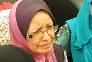 Speculate all you want I know my son is alive says MH370 passenger s mum