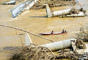 Kelantan floods tear down concrete bridge