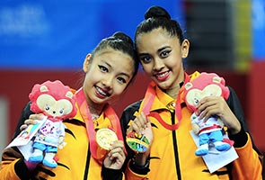 Winning two gold medals in one event an unbelievable experience, say M'sian gymnasts