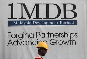 Polis serbu pejabat 1MDB