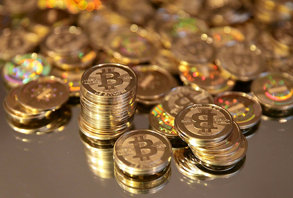 Futures in bitcoin, which has taken global financial markets by storm, got off to a volatile start at its launch.