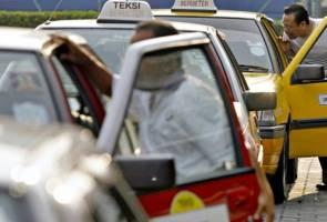 Pemandu teksi dialu-alukan sertai Grab
