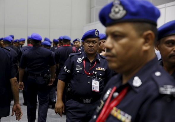 Malaysian police leave a security briefing at the 27th Association of Southeast Asian Nations (ASEAN) summit in Kuala Lumpur, Malaysia, November 18