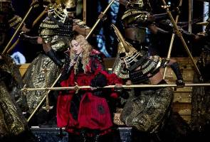 Madonna continues her reign as Queen of Pop and highest-grossing solo touring artist