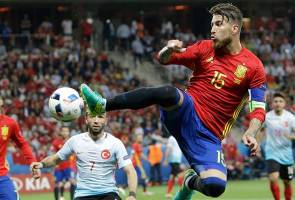 Spain cruise to last-16 with Turkey win
