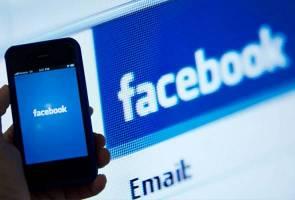 Facebook user Catt Ginger arrested for allegedly insulting Agong
