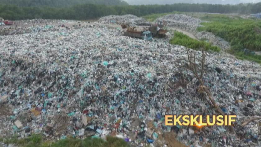 loji insinerator bernilai hampir RM70 juta di pulau itu tidak berfungsi sejak sekian lama selain sampah dari seluruh pulau terpaksa dilonggokkan di tanah lapang bersebelahan insinerator tersebut. - Foto Astro AWANI