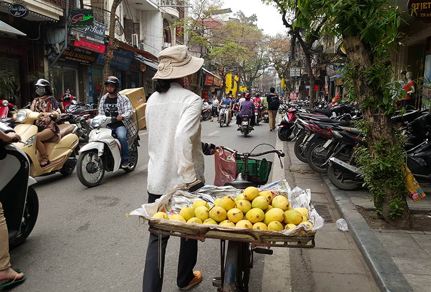 Motorcyclists and peddlers are often seen whizzing through the busy streets of Hanoi.