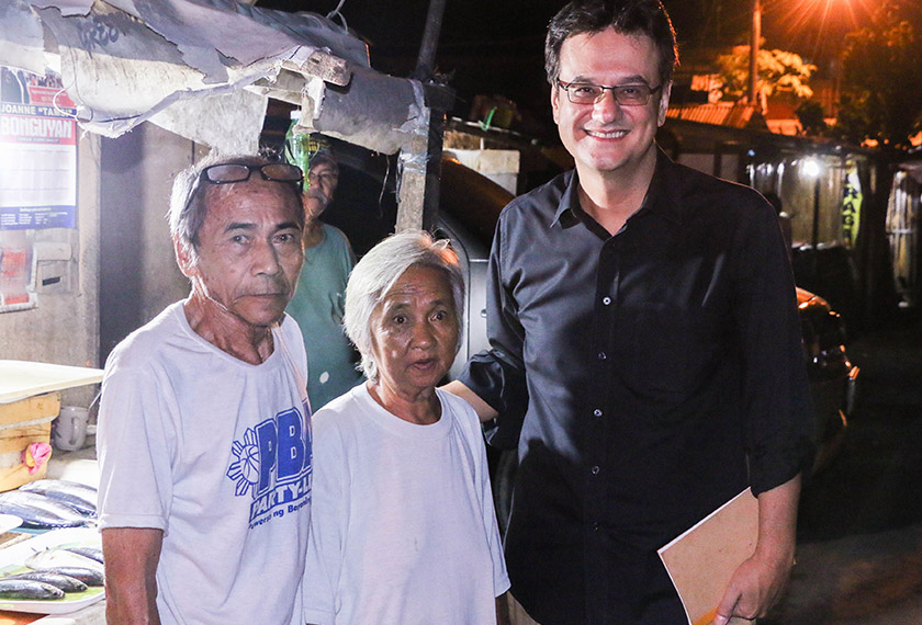 Karim with Barangay leader and Duterte supporter, Mang Remy, and his wife. - Karim Raslan Photo