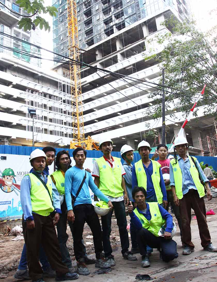 Pak Tukin and his friends before getting to work at the construction site. - Karim Raslan Photo