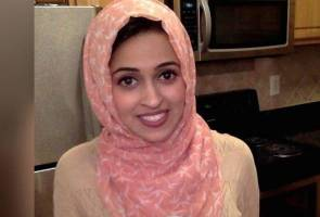 A Muslim teacher receives a note about her headscarf: 'Hang yourself with it'