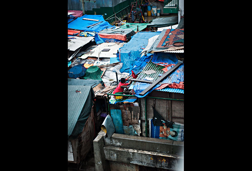 Locals often refer to slum houses as squatter homes as the makeshift structures are built on public property. - Photo by Karim Raslan