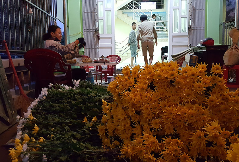 Vendors preparing flowers to sell at the night market. - Photo by Karim Raslan