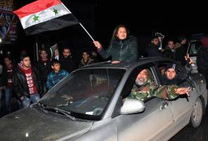 'Life returned to Aleppo today', say Assad supporters as they celebrate regime victory