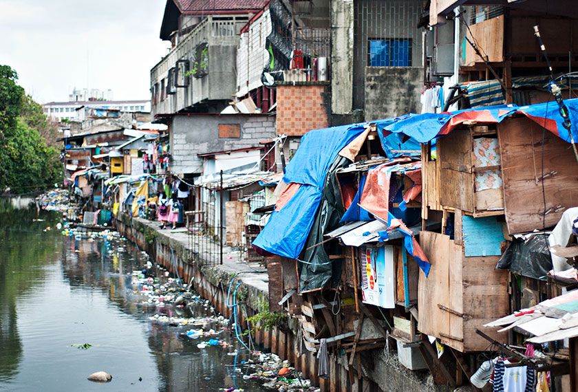 Slum homes near the Pasig River that runs through the Philippine capital. - Photo by Karim Raslan