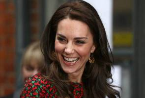 French magazine found guilty over topless photos of Kate Middleton