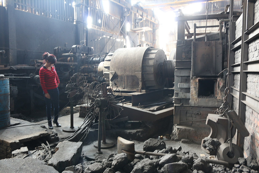 Trần Thị Lợi in her steel production facility which produces construction materials from iron ingots. The machine besides her costs USD350,000. Karim Raslan Photo