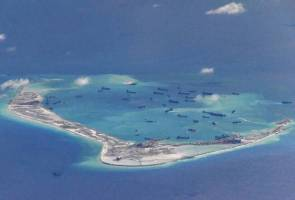 Australia, Japan, US call for South China Sea code to be legally binding