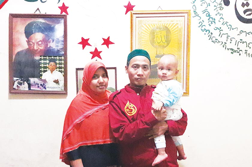 Ahmad Zakarsih with his family at their home in Bekasi. He and his wife had an arranged marriage and are now raising their two-year- old son. - Karim Raslan Photo