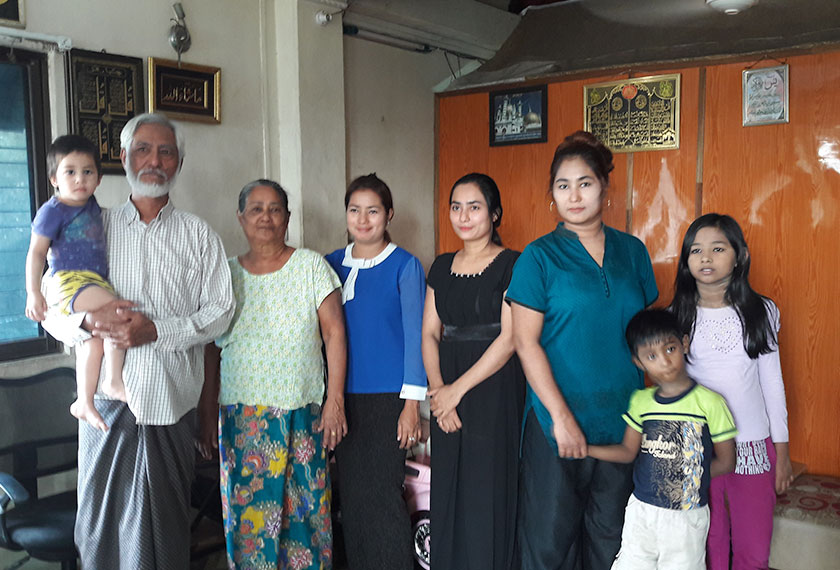 U Tin Win with his family in their home in Yangon. - Photo by Karim Raslan