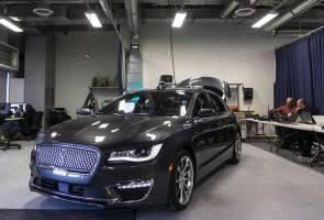 Ford's dozing engineers side with Google in full autonomy push