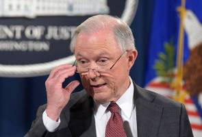 Under fire, Trump's attorney general removes himself from campaign probes
