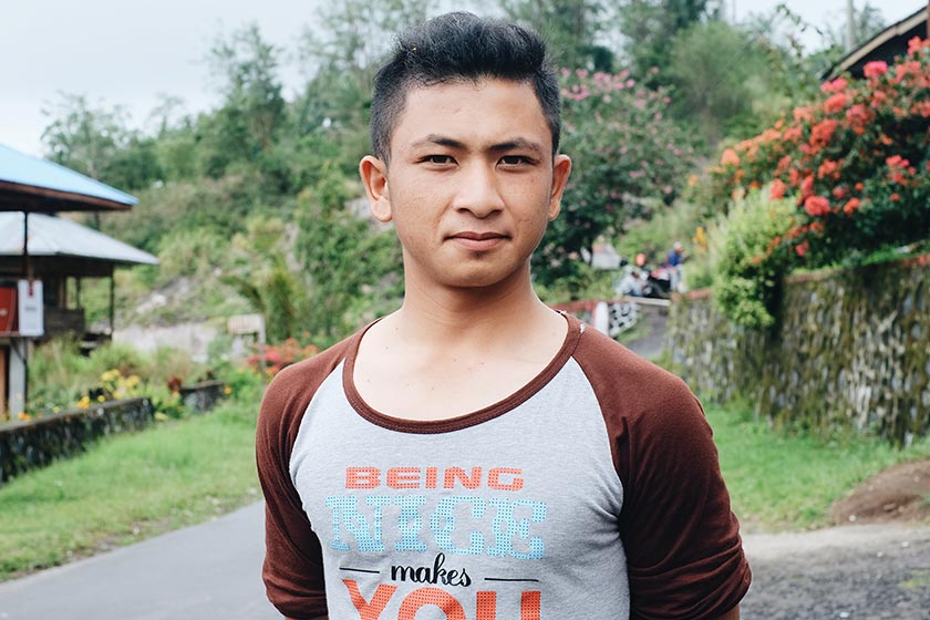 Fernando Pantow, 22, worked as an illegal gold miner for six years before becoming a tour guide amidst Manado's tourism boom.