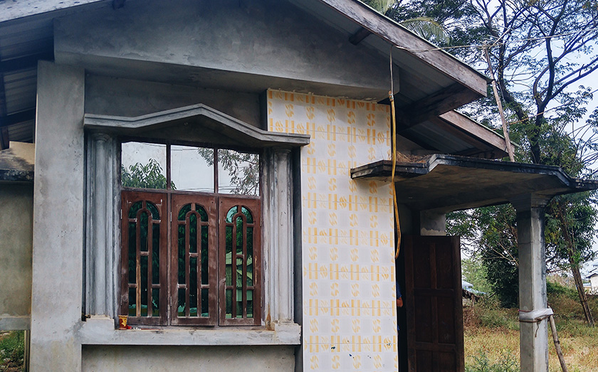 U Ko Aye owns one of the few concrete houses in a village of mostly wooden homes. Karim Raslan Photo