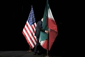 U.S. says Iran complies with nuke deal but orders review on lifting sanctions
