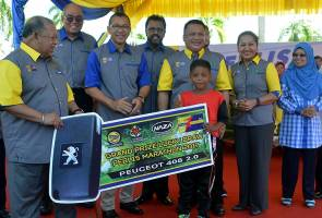 Pupil, 9, drives away with Peugeot 408 car in Perlis Marathon lucky draw