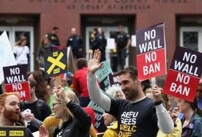 In travel ban case, US judges focus on discrimination, Trump's powers