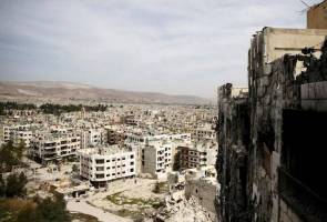 Syrian army retakes most of rebel-held district on capital's edge